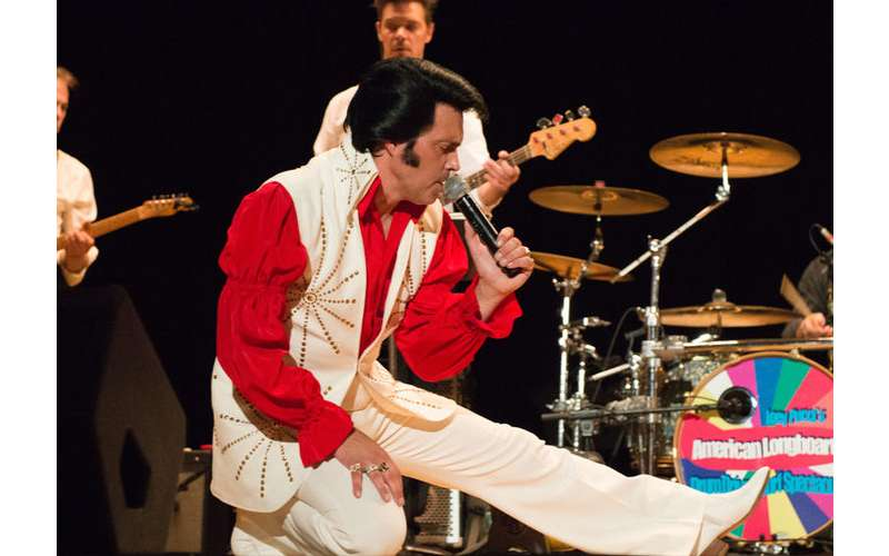elvis impersonator james cawley on stage