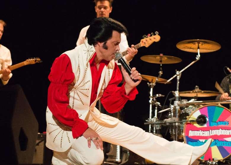 elvis impersonator james cawley on stage