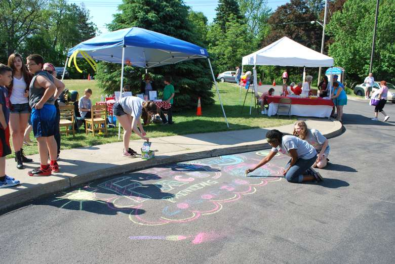 some people making chalk drawings