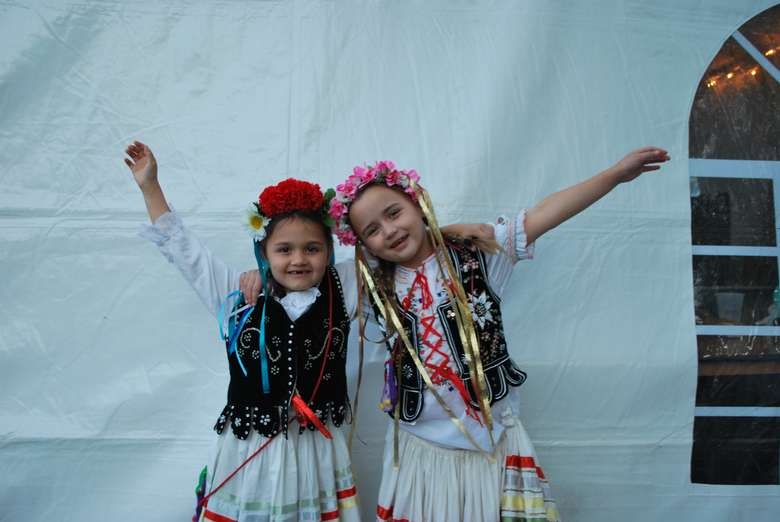 two girls dressed in polish clothing