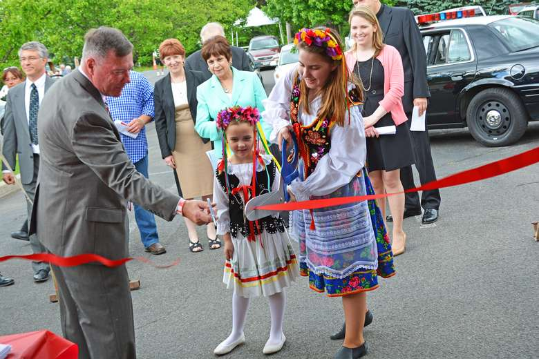 a red ribbon cutting at a polish festival