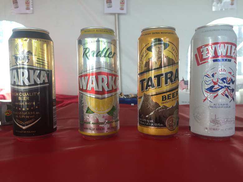 four polish drinks in cans