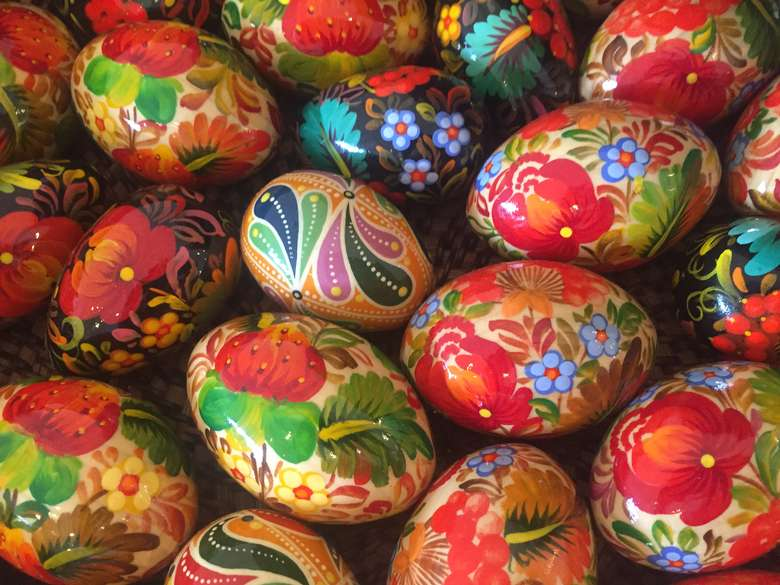 colorful eggs with painted images on them