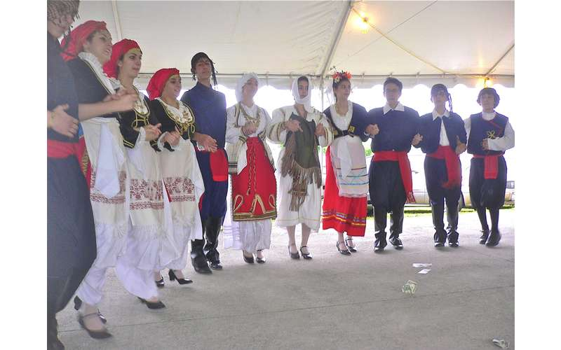 group dressed in traditional greek attire