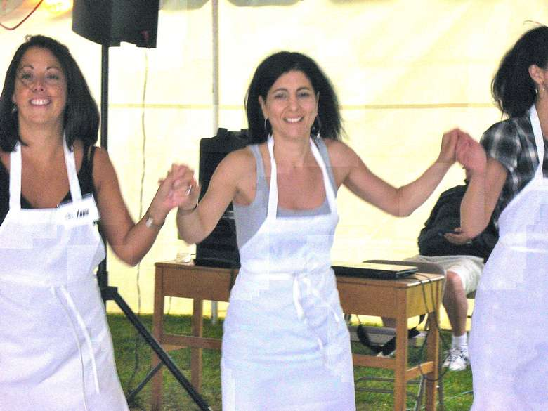 woman dancing in white aprons