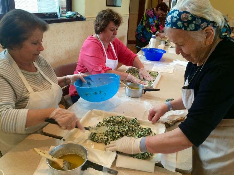 women preparing food at table