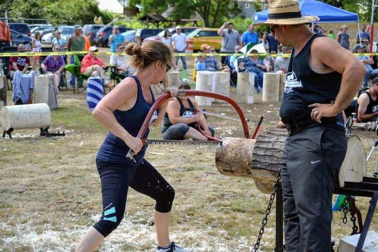 woman sawing lumber