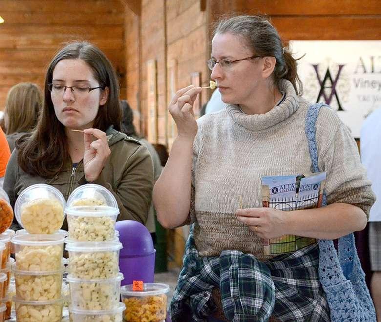 two women sampling food