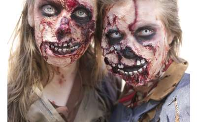 two zombies pose together like a couple
