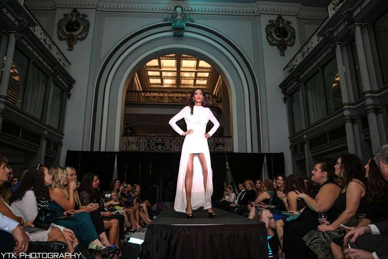 a woman modeling on the runway
