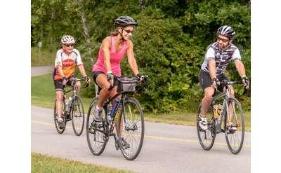 three people riding bikes
