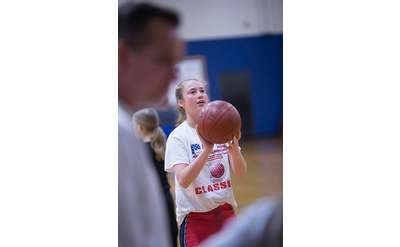 young girl about to shoot a basketball