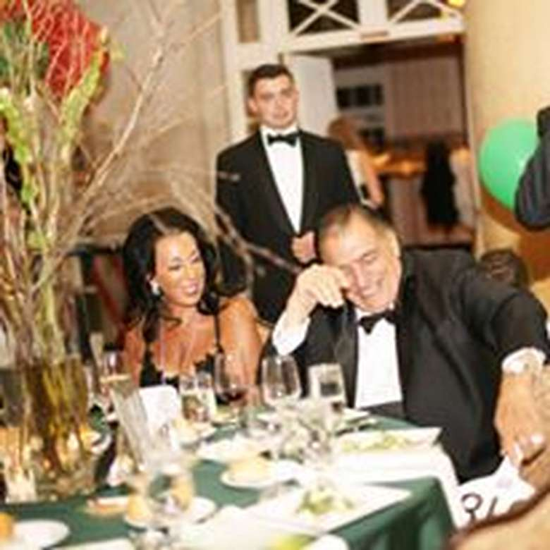people at a gala dinner table