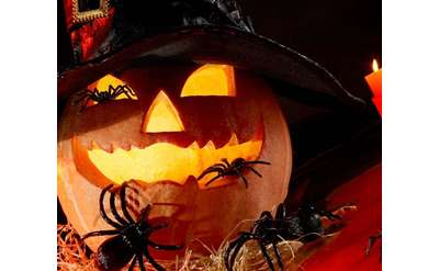 a spooky jack o lantern with spiders