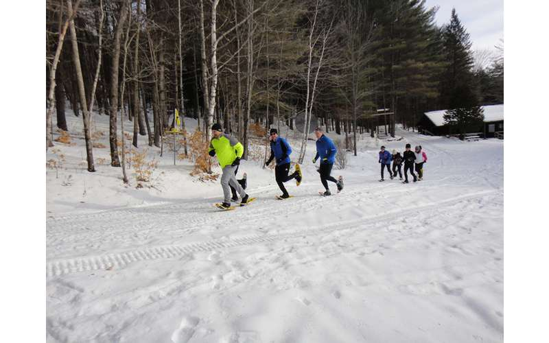 Snowshoe runner starting up the trail
