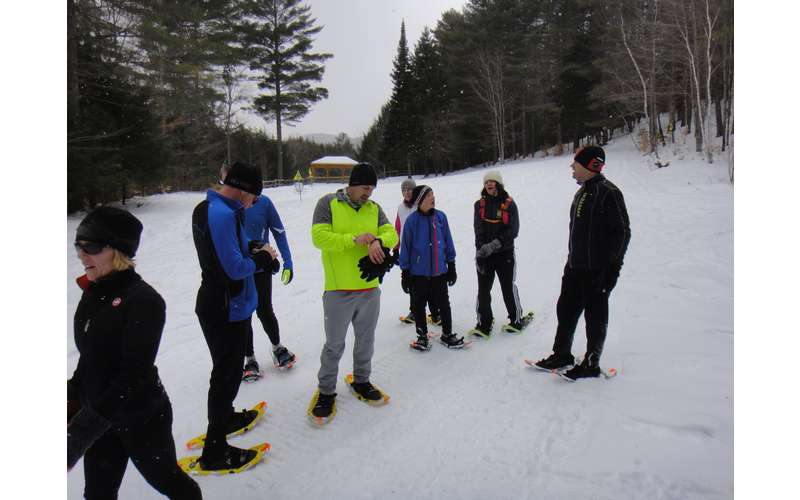 Snowshoe runners checking times