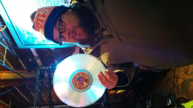 dj holding a vinyl
