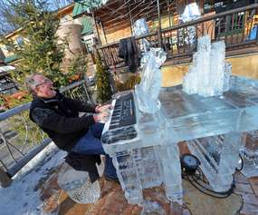 man playing an ice piano