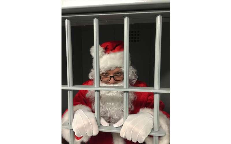 a Santa behind bars