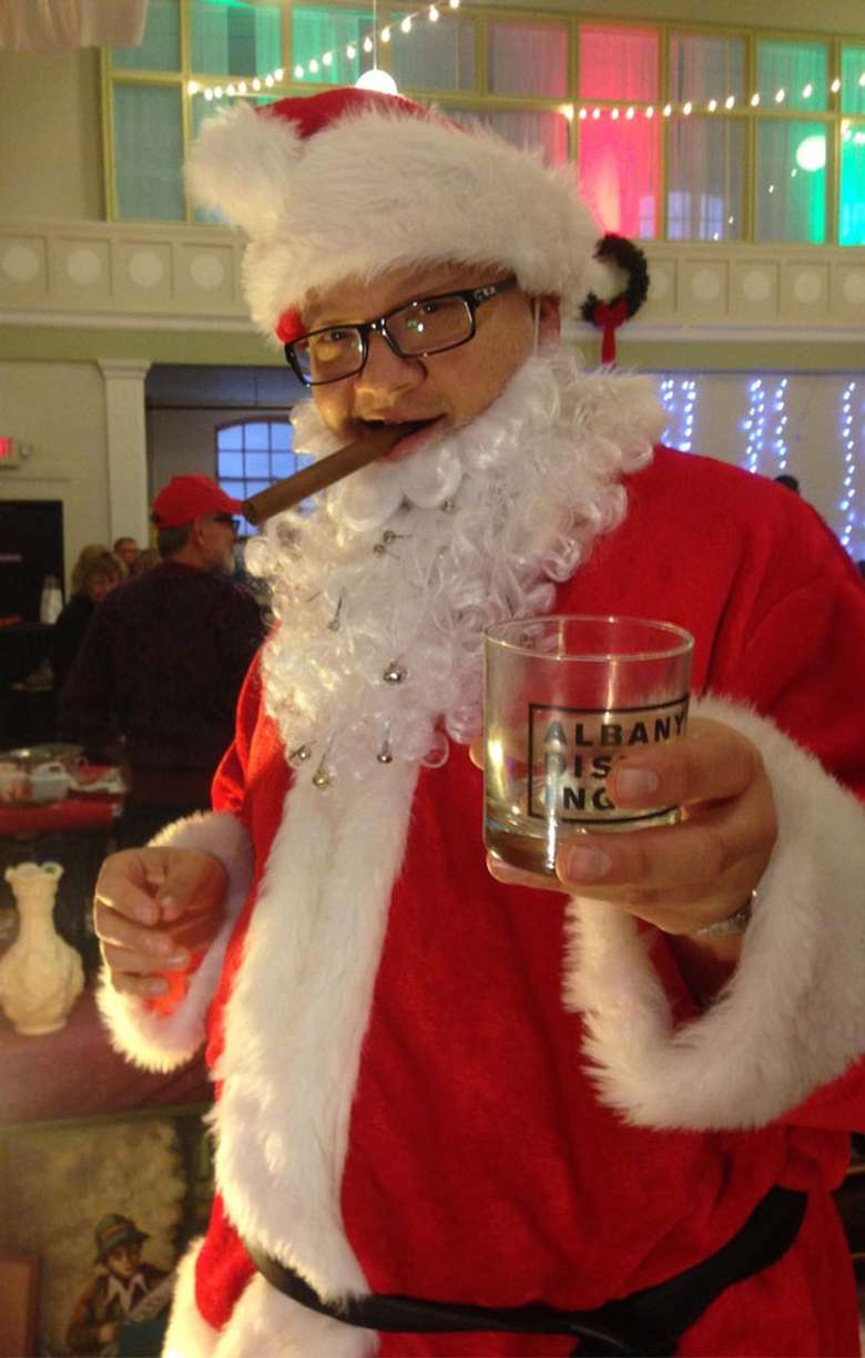 Santa with a cigar and a drink
