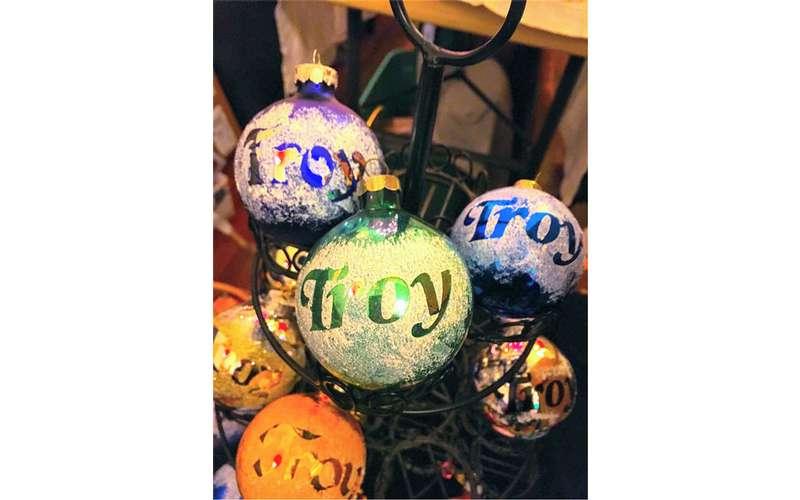 bulb ornaments that say Troy on them