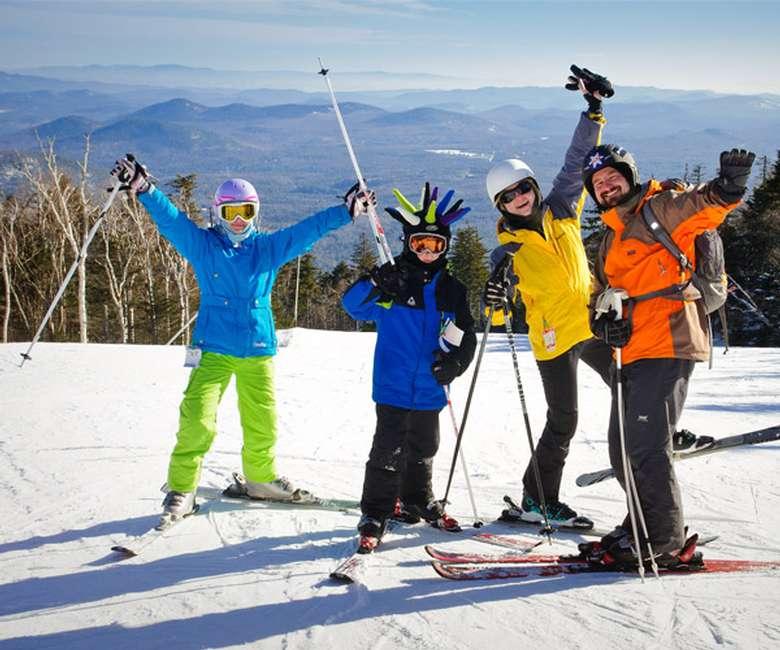 four people on skis at a ski mountain