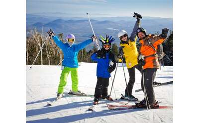 four people on skis at a ski mountain
