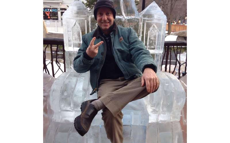 a man sitting in an ice chair