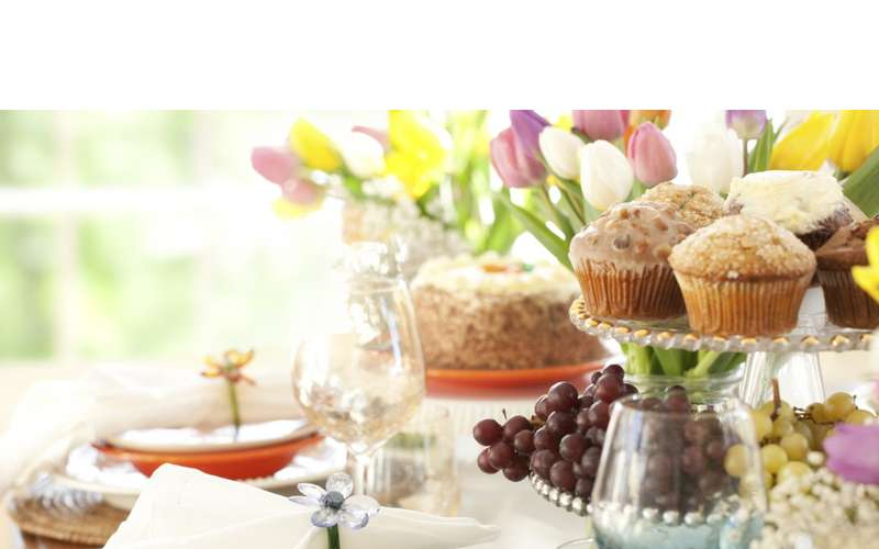 muffins and other brunch food near flowers