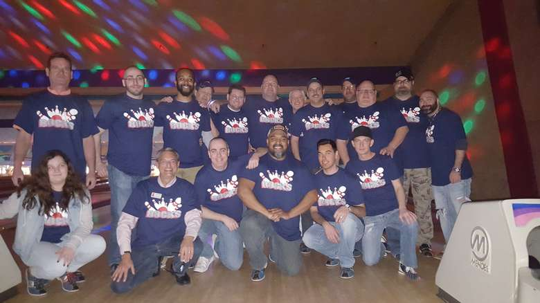 large group with the same bowling shirt