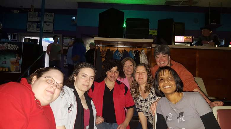 seven people in bowling alley seats