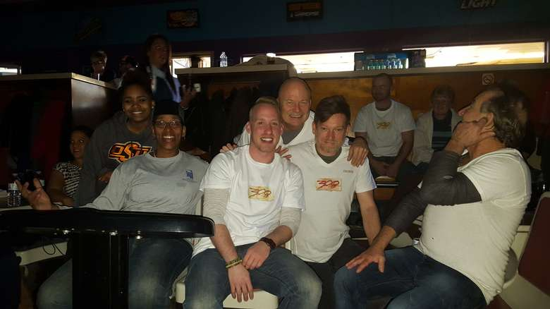 six people at a bowling alley booth