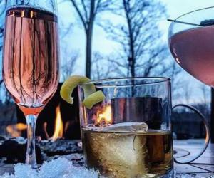 three alcoholic beverages on ice outdoors