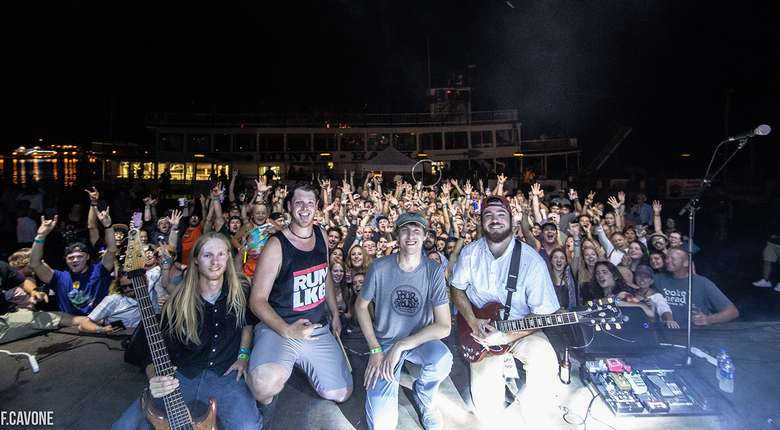band members in front of crowd