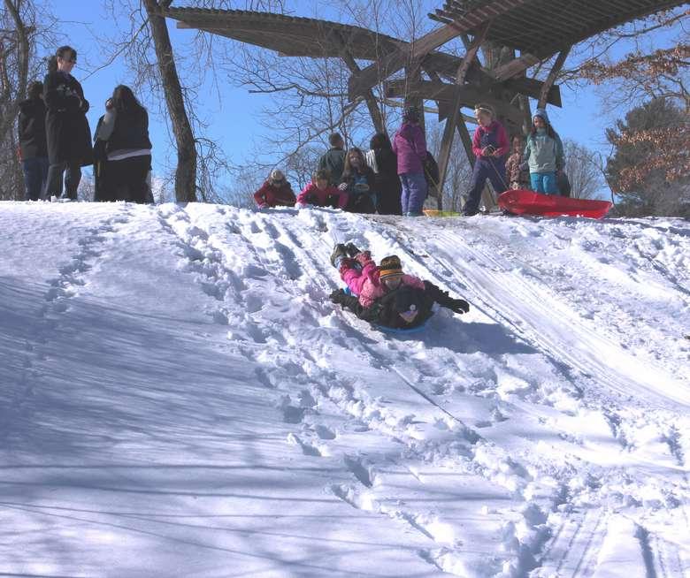 sledding down a hill