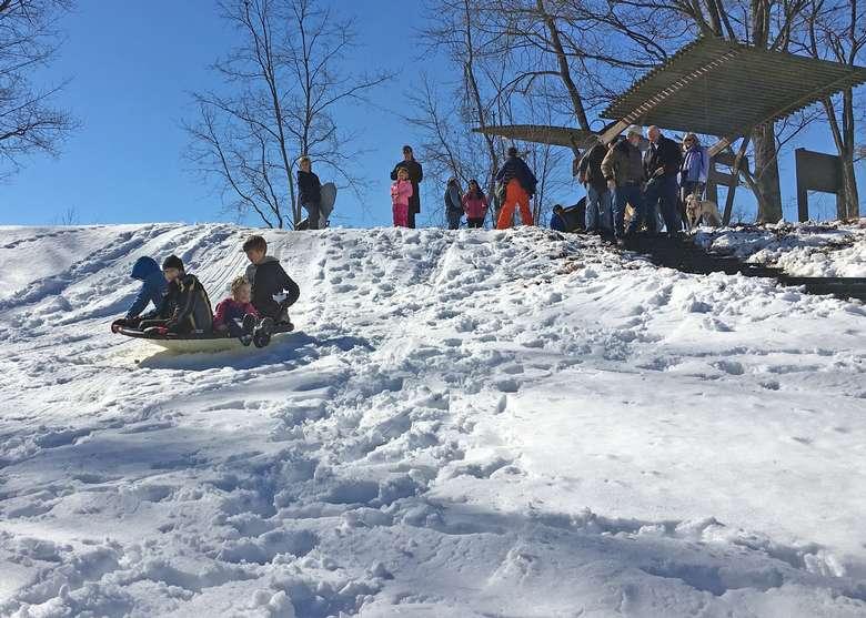 saucer snow sledding