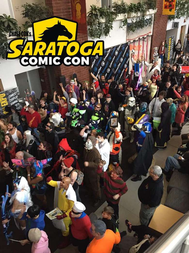 a crowd of people at a comic con
