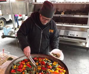 chef with big bowl of hot peppers