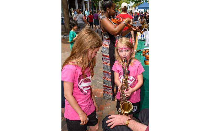girl playing a saxophone