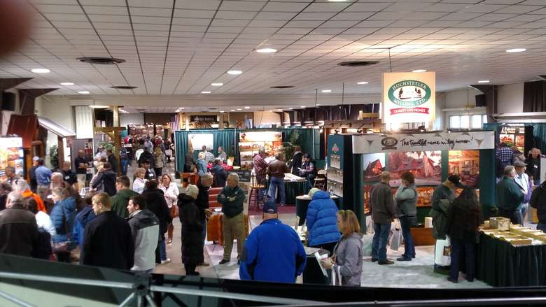 people at a crowded indoor expo