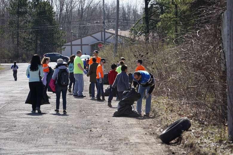 group of volunteers walking down road