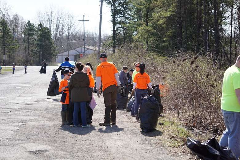 group of volunteers picking up trash