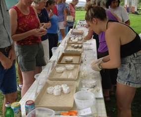 a line of people sampling cheeses