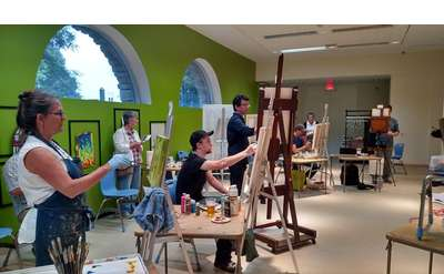 last year's art battle, artists painting