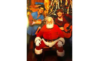 Santa posing with musicians