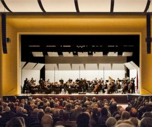 glens falls symphony performing in a full auditorium