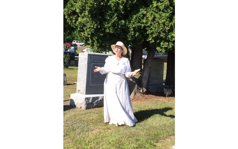 woman reenactor dressed in white dress