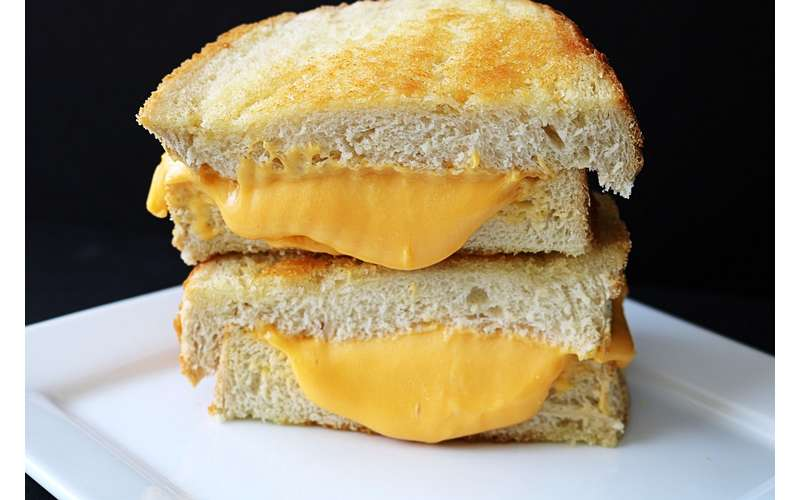stacked grilled cheese with melted cheese oozing out