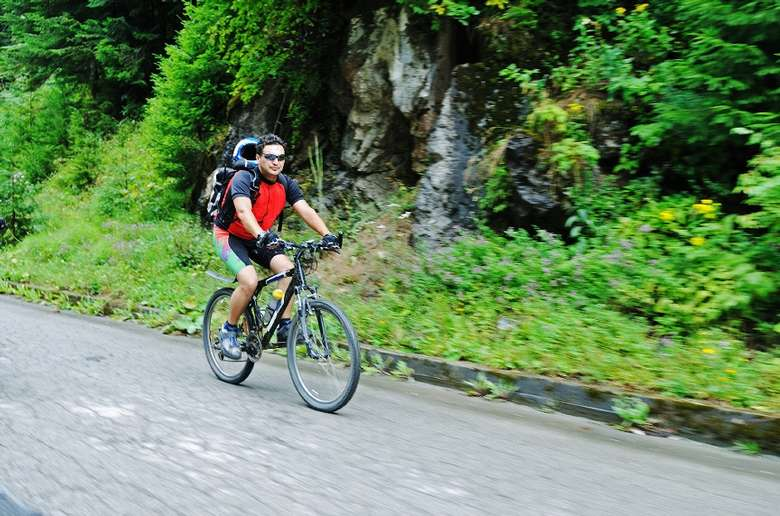 one mountain biker on a road