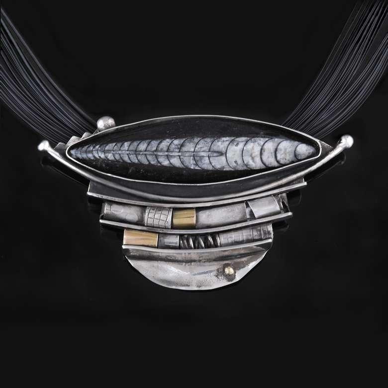 silver piece of jewelry